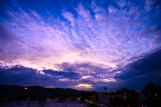 Pink, Purple, Yellow and Blue Dynamic Clouds at Sunrise