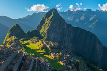 Close up of the Machu Picchu, the lost city of the Inca, at sunset with the last sun rays shining on the ruin, located in the Urubamba valley near Cusco, Peru, South America.