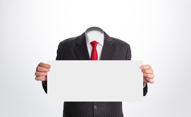 Headless (invisible) businessman holding a white card on white