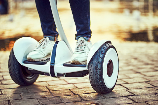 Human legs and feet on hoverboard  park paths