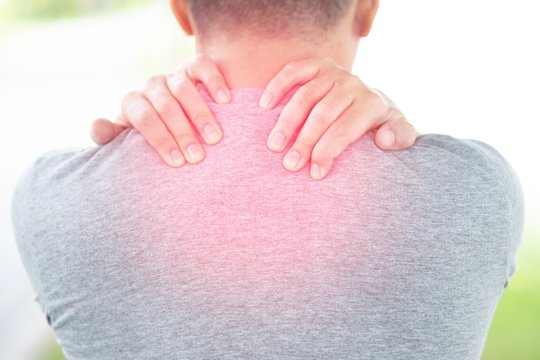 The image of a man put his hand on the nape.