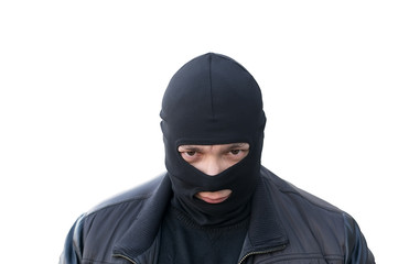 criminal in a black balaclava on an isolated background