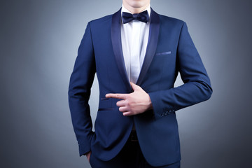 Photo of stylish man in elegant blue suit