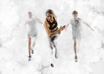 Men and woman running on smoke background. Mixed image