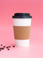 White To Go Coffee Cup with coffee beams on a pink background. Mockup with copy space for your logo