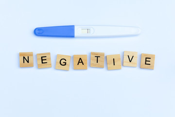 Negative pregnancy test stick with the text 'negative'