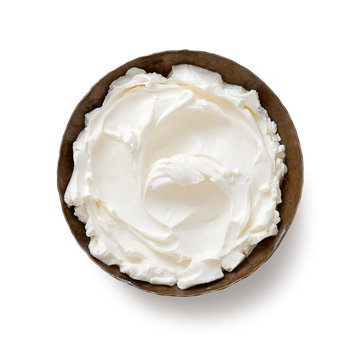 Bowl of cream cheese isolated on white background, top view .