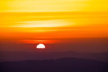 Dramatic sunset and sunrise over mountain morning evening sky.
