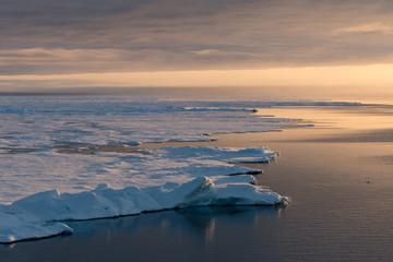 Midnight sun on calm Svalbard sea