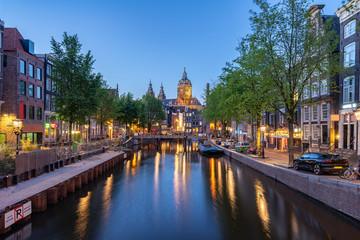 Wall Mural - Saint Nicholas Church at night in Amsterdam city, Netherlands