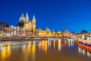 Wall Mural - Amsterdam city with Saint Nicholas church and canal in Amsterdam city, Netherlands