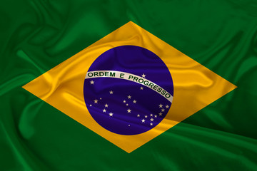 photo of the national flag of Brazil on a luxurious texture of satin, silk with waves, folds and highlights, close-up, copy space, travel concept, economy and state policy, illustration