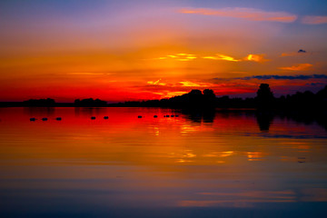 Colorful sky in sunset over the lake