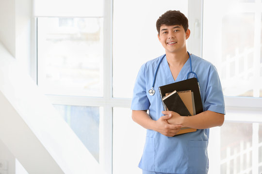 Asian student of medical university near window