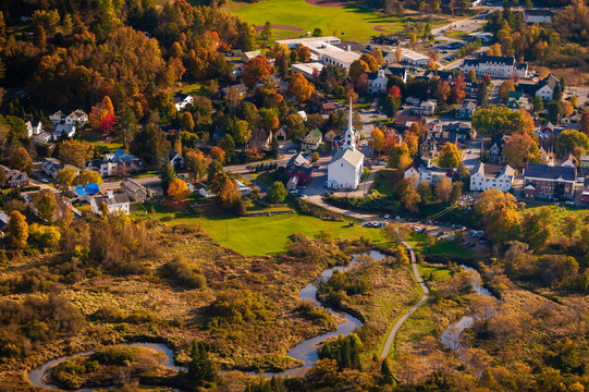 Aerial view of the town of Stowe Vermont on a colorful autumn afternoon