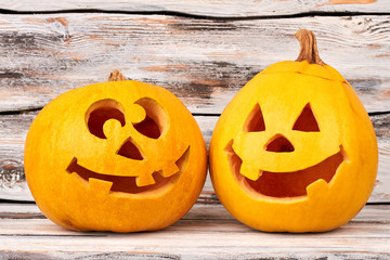 Funny Halloween pumpkin on wooden background. Preparation for Halloween. Head carved from a pumpkin for Halloween holiday.