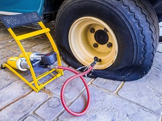 Flat tire and air pumper tool fixing and refill air to old tire of golf cart.