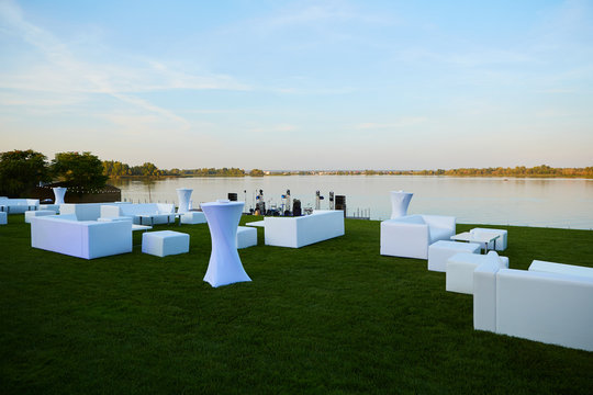 Lounge area for guests outside. White sofas and tables