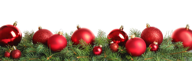 Fir tree branches with Christmas decoration on white background