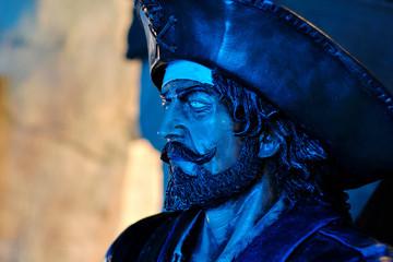 Close up face of pirate sculpture indoors