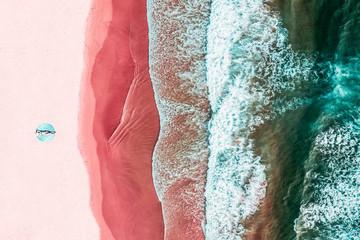 Fototapeta Aerial View Of Woman On Pink Ocean Beach