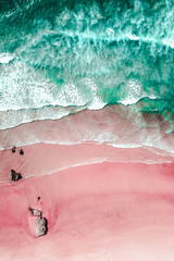 Foto auf Leinwand Rosa hell Aerial View Of Ocean Waves And Beautiful Pink Sandy Beach Shore