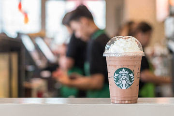 BANGKOK, THAILAND - January 14, 2017: Starbucks coffee cold beverage on table, famous coffee brand franchise originated in USA