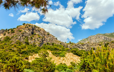 Rocks hills mountains island sea