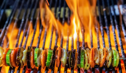 Kebabs mixed vegetables skewers Cooking grilling on flaming grill steamed