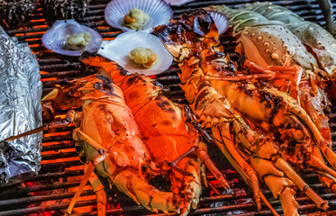 Lobster grilling barbecue on aluminum foil