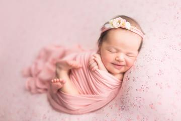 first photo shoot. newborn child. newborn.  the baby is lying on a pink blanket. newborn girl