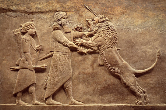 Assyrian relief of royal lion hunt, Babylonian and Sumerian art. Remains of ancient civilization of Mesopotamia. Middle East history concept.