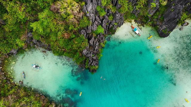 Aerial view of a blue lagoon and limestone cliffs, El Nido, Palawan, Philippines
