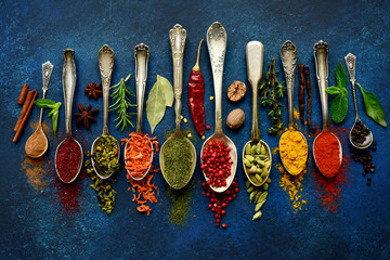 Fotobehang Kruiden Assortment of natural spices on a vintage spoons.Top view with copy space.