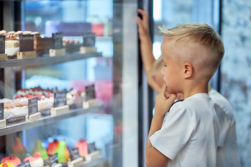 two little boy in a cafe looks at the window