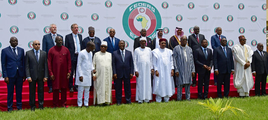West African leaders and officials pose for a family photo at the ECOWAS extraordinary summit on terrorism in Ouagadougou
