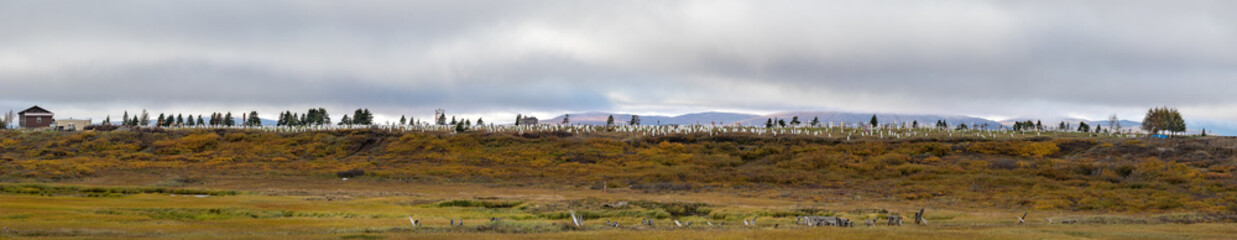 Panorama of the Nome Cemetery with white grave markers, Nome, Alaska.