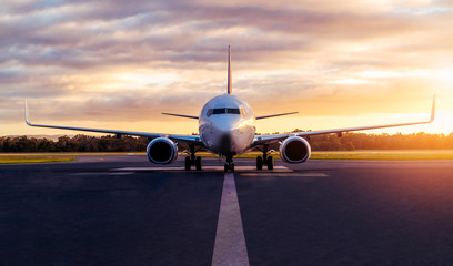 Printed kitchen splashbacks Airplane Sunset view of airplane on airport runway under dramatic sky in Hobart,Tasmania, Australia. Aviation technology and world travel concept.