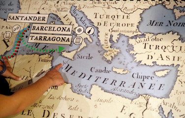 German captain of Sea Watch 3 Carola Rackete points to a map during an interview at Maritime Museum of Barcelona