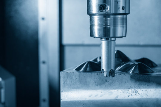 The CNC milling machine rough cutting the mould parts with the indexable radius endmill tools. The mold and die manufacturing process by machining centre with the indexable tools.