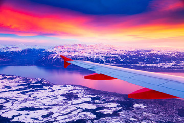 Amazing view from the airplane window during the sunset over mountains in Switzerland Fototapete