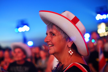 A reveller wearing an English flag hat enjoys 'The Last Night of the Proms' celebration in Hyde Park, London