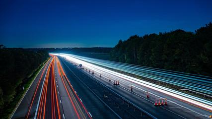 Tuinposter Nacht snelweg Long exposure of motorway at night - Harvest moon