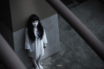 Woman ghost horror standing under building house her looking up,