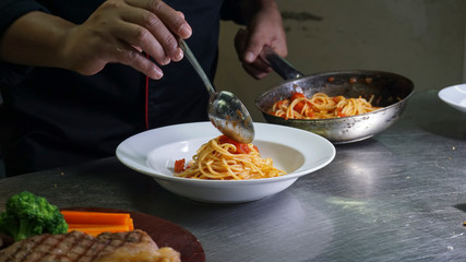 chef plating spaghetti