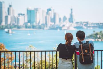 Australian couples looking and enjoy beautiful landscape view of Sydney cityscape, Australia. Travel or tourism concept.