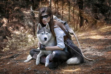 Fairytale art photo of a hunter with a wolf and a bow