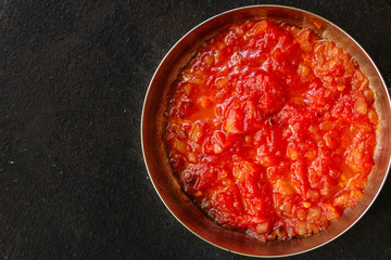 tomato sauce, skinless tomatoes - red and ripe fruits chopped, concept. food background. copy space