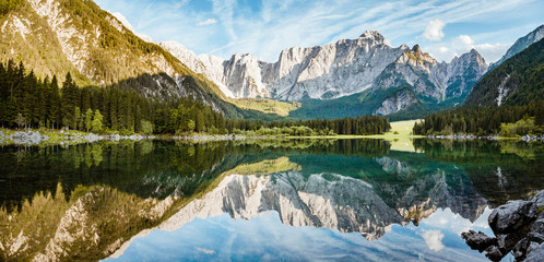 Foto op Canvas Alpen Alpine peaks reflecting in tranquil mountain lake at sunrise