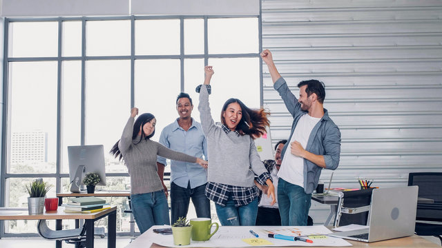 group of creative designer dancing in office with relax feeling and glad about good success news of project at modern office.business day work lifestyle.